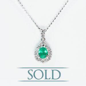 Platinum Natural Emerald and Diamond Halo Pendant